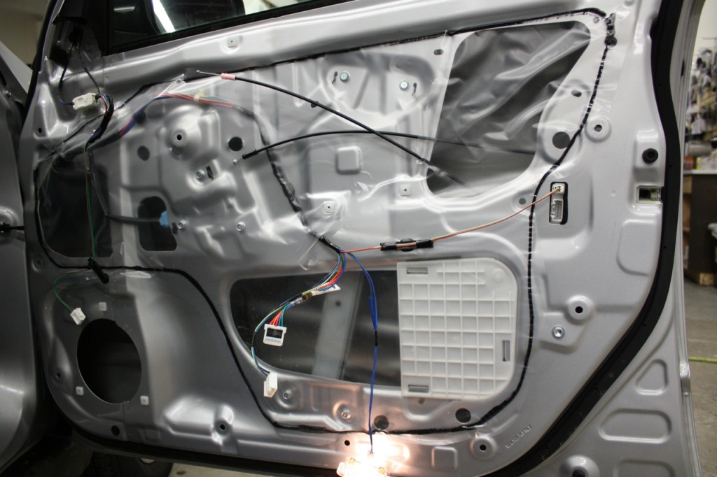 You need Dynamat in your door panels.