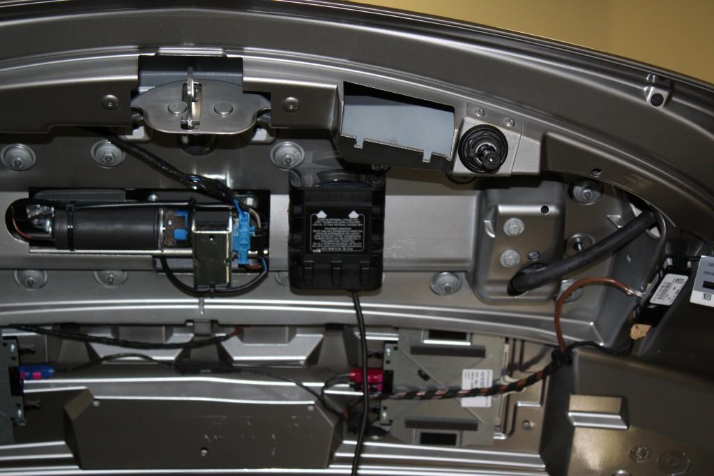 Stealth install of rear radar sensor in trunk lid of Mercedes SLS AMG